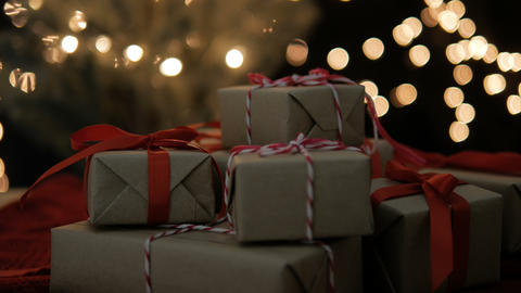 New Year and Christmas Gift boxes with bokeh lights GIF