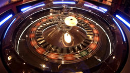 Aerial view of Roulette Wheel spinning under glass sphere with reflections of Footage