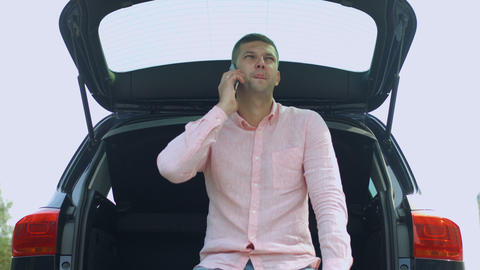 Portrait of serious man talking on cellphone in car Footage