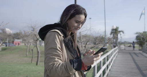 Beautiful woman browsing and texting on the phone,... Stock Video Footage