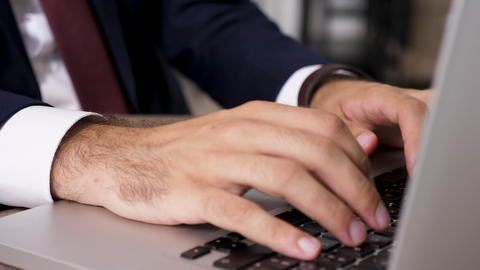 Revealing dolly zoom in footage businessman hands typing fast on computer Footage