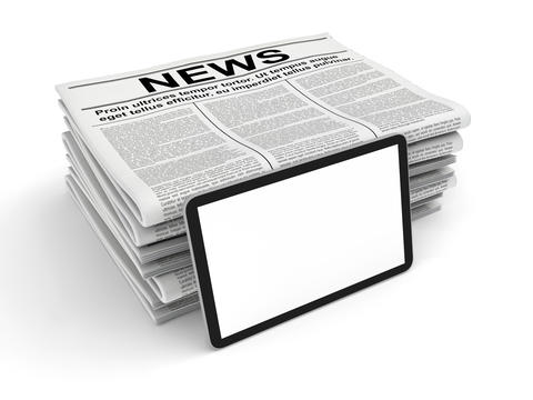 News in the newspaper and blank tablet PC, isolated on white Photo