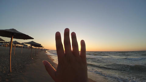 Hand fingers sun sunset sunset beach sea ocean Live Action