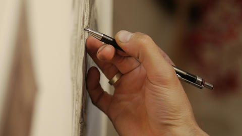 Man artist draws with a graphite pencil GIF