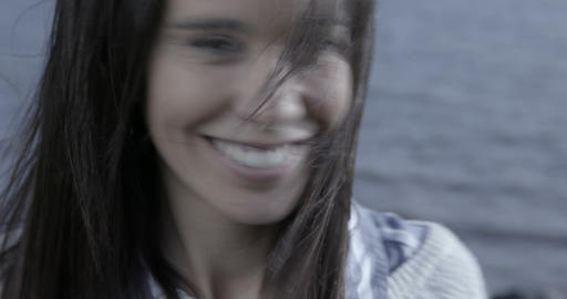 Close up of a beautiful woman on a riverside shaking... Stock Video Footage