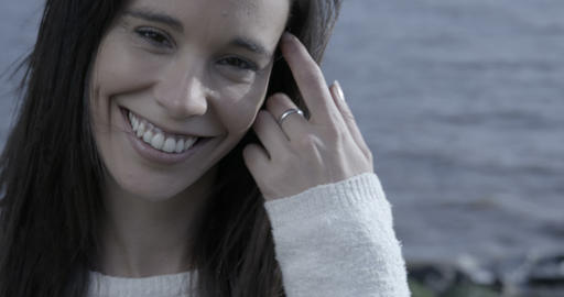 Close up of a beautiful woman on a riverside laughing and... Stock Video Footage