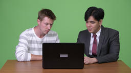 Young Asian businessman and young Scandinavian... Stock Video Footage