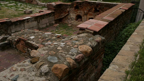 Brick ruins of spiritual heritage of church in middle of housing estate, history Live Action