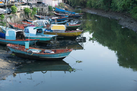 Thai traditional fishing boats park at the canal that connect to Photo