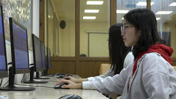 A group of Asian students use computers during training Footage