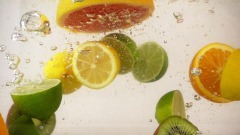 Halves of different fruits falling with splashes in water, multifruit set, slow Footage