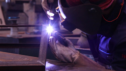 worker welding steel with a gas welding machine, slider shot Footage