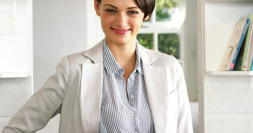 Portrait of businesswoman smiling with hand on hip Footage