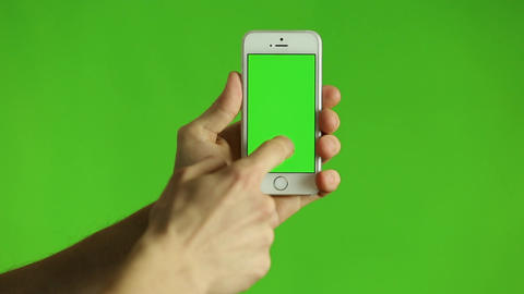 Finger Pointing At Smart Phone With A Green Chroma stock footage