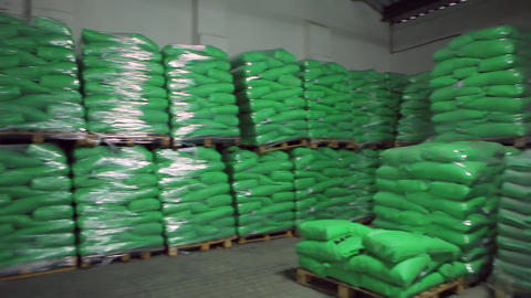 Green Bags with Products in Stock Warehouse Footage
