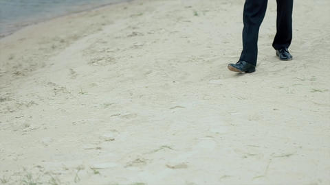 Man Walking Along The Shore Of The Lake stock footage