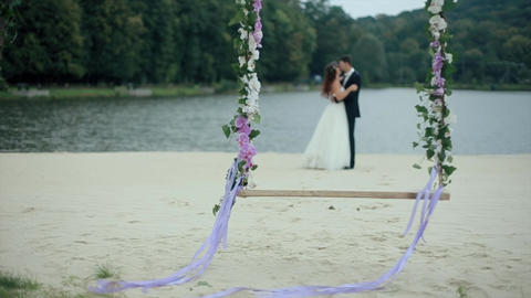 Wedding Bouquet on Seesaw with Married Couple Footage