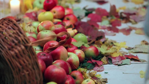 Scattered Red Apples Lie on a White Canvas Live Action