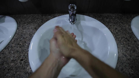 A man approaches the tap opens the tap Footage