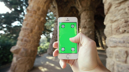 Man Using Phone In Natural Grotto, Parc Guell stock footage