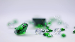 Parade Of Perfect Diamonds Rotating Slowly Above A White Surface With Sparkling  stock footage