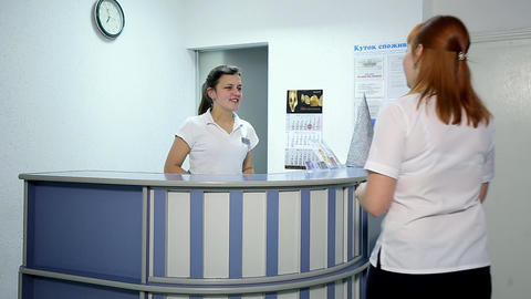 Young doctor Talking with Patient at Hospital Reception Desk Footage