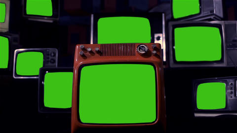 Many Old Tvs With Green Screen. Night Tone. Zoom Out Live Action