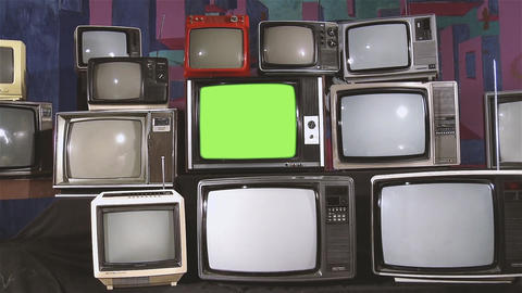 Old Tv with Green Screen and Many Old Tvs. Aesthetics of the 80s. Zoom In Footage