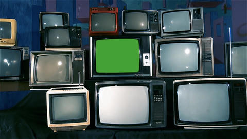 Old Tv with Green Screen and Many Old Tvs. Aesthetics of the 80s. Zoom Out. Blue Live Action