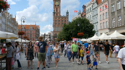 Gdansk, Poland. The town hall, the Long Street and strolling people Live Action