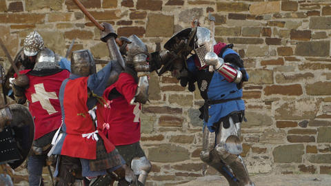 One blue knight resist to group of red team warriors Slow motion footage GIF