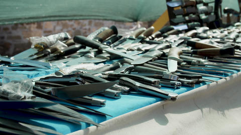 Much knives and blades on the merchant table Cold weapon Live Action