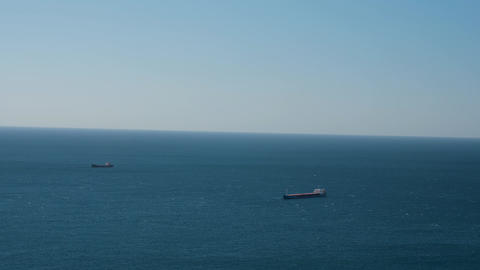 cargo ships in open sea GIF