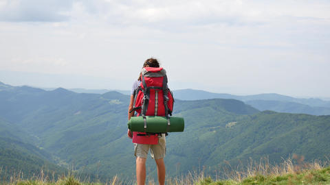 Hiking - hiker man on trek with backpack living healthy active lifestyle. Hike Live Action