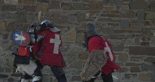 Medieval rumble of armored warriors Defeat on the battlefield GIF