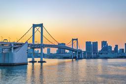 Tokyo Japan, sunset city skyline at Odaiba Rainbow Bridge Photo