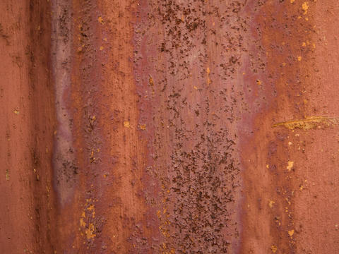 Rusty iron wall, background of an old piece of metal Photo