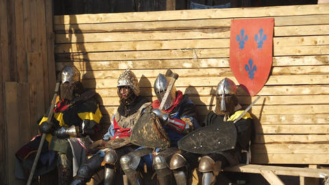 Team of warriors is resting on the wooden bench Live Action
