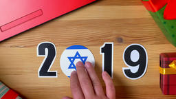 Illustration, new year, male hand put on the table on Israeli flag, country ball Footage