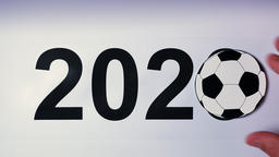 Illustration, new year, male hand put on the table on soccer ball, 2020 Footage