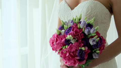 An Attractive Young Woman bride with a Bouquet of Flowers in a Luxurious Room Footage