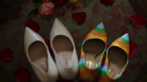 shoes stand on a transparent glass table indoors Stock Video Footage