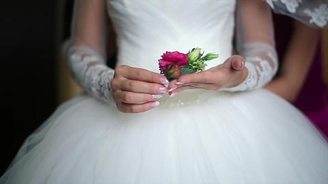 Bride is Holding a Red Boutonniere Flowers Footage