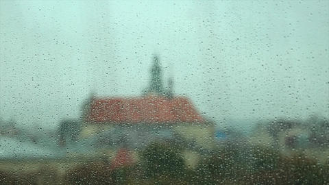Rain Drops on the Glass of a Window, with Defocused Buildings in the Background Footage