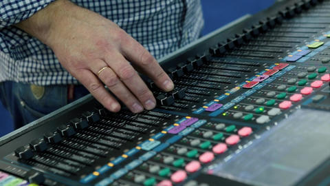 A Sound Engineer Using A Mixing Desk Or Mixing Console To Mix A Track In A Recor stock footage