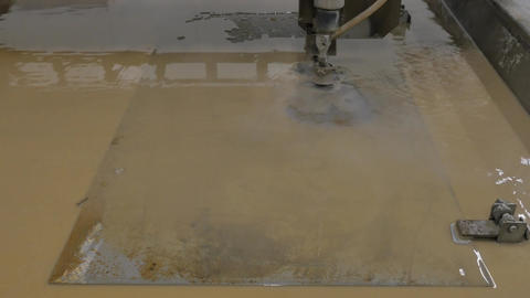 Cutting of Sheet Brown Metal Easel Logo Static Footage