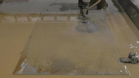 Cutting of Sheet Brown Metal Easel Logo Static Footage
