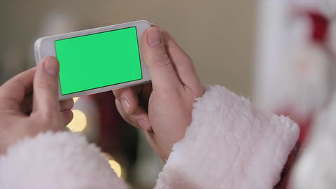 Santa Hold Phone In Hands Green Screen. Phone With Green Screen In Landscape Mod stock footage