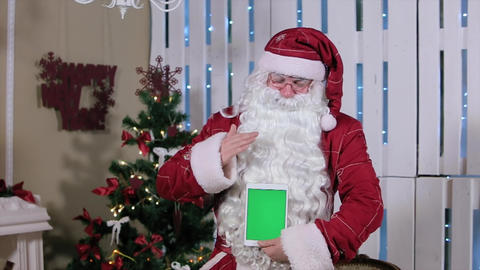 Santa Stroke Tablet With Green Screen Holding Vertical Mode. Tablet With Green S stock footage