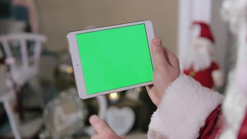 Santa Claus Work on Digital Tablet Green Screen. Tablet with Green Screen in Lan Footage